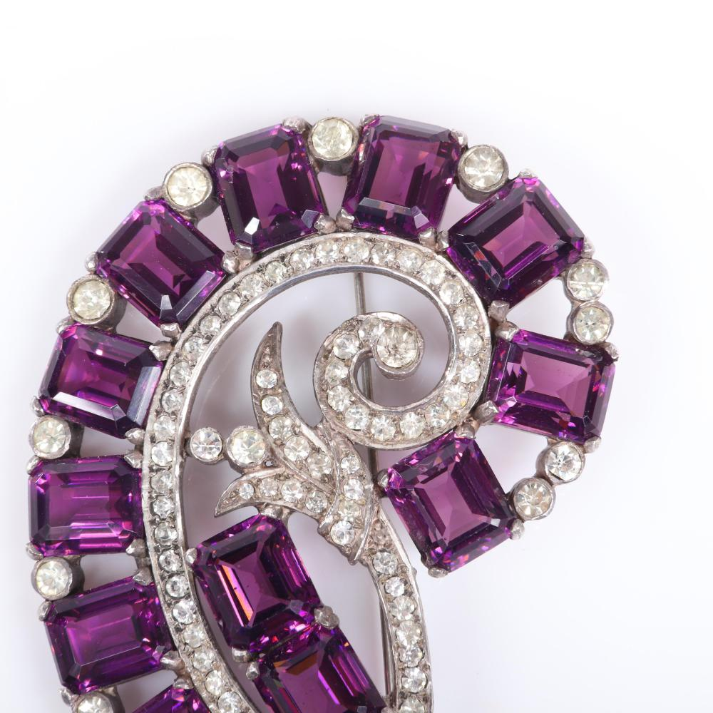 "Eisenberg Original sterling nautilus brooch with fourteen emerald-cut deep amethyst crystals in swirling pattern and pave and bezel-set rhinestones, mid-1940s. 2 5/6"" x 3 1/4"""