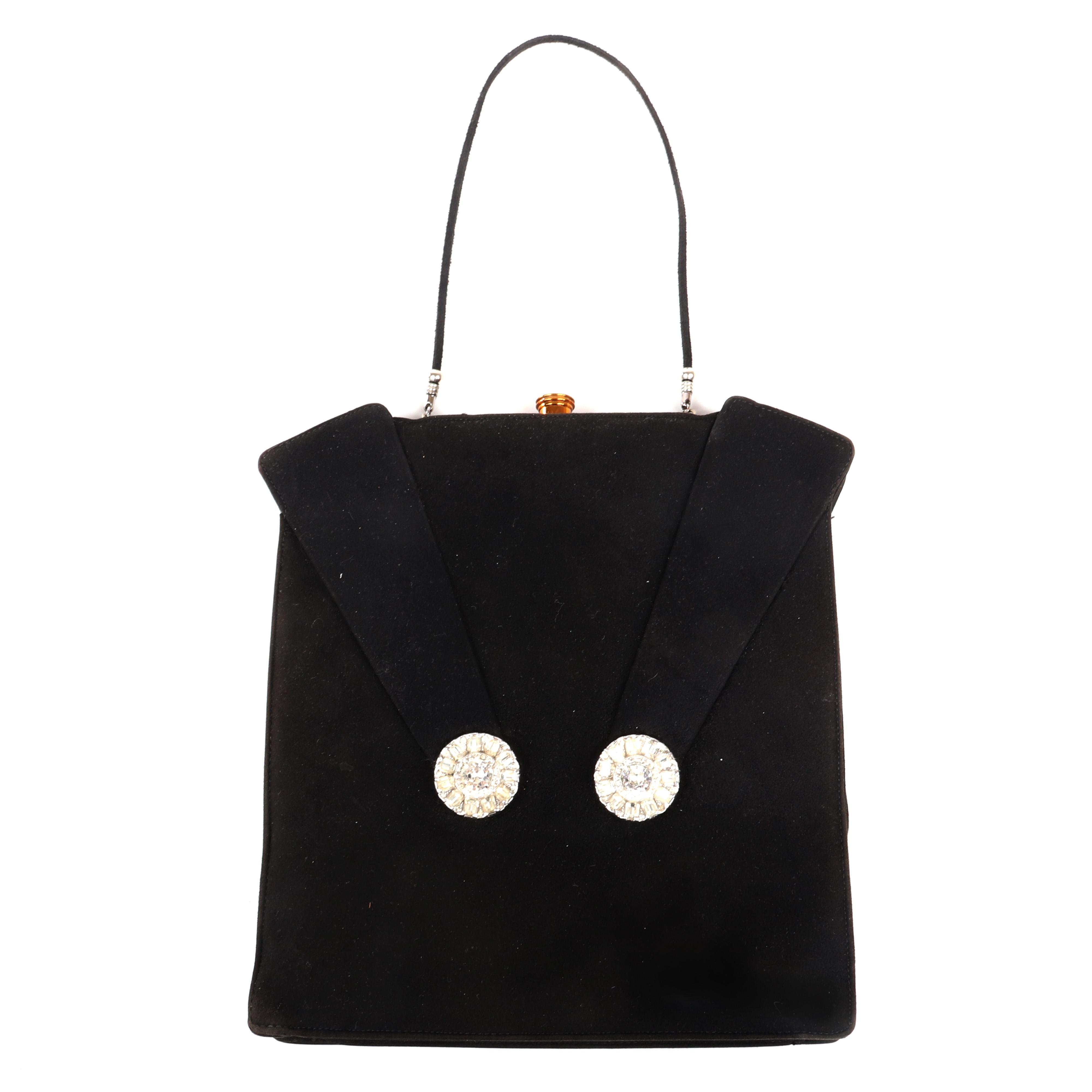 """Eisenberg Original Rare black suede handbag with decorative suede fold-over flaps held by two stunning rhinestone buttons, gold hardware and push button strap, c. 1950. 9 1/4"""" x 8 1/4"""""""