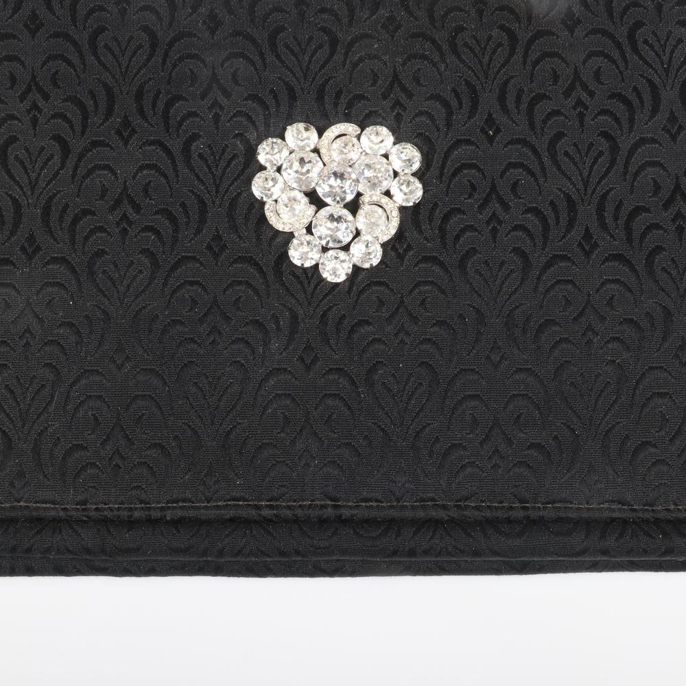 """Eisenberg Original black brocade clutch handbag with faceted rhinestone and pave half moon accents, with original mirror and change purse, c. 1950. 7 1/2"""" 14"""""""