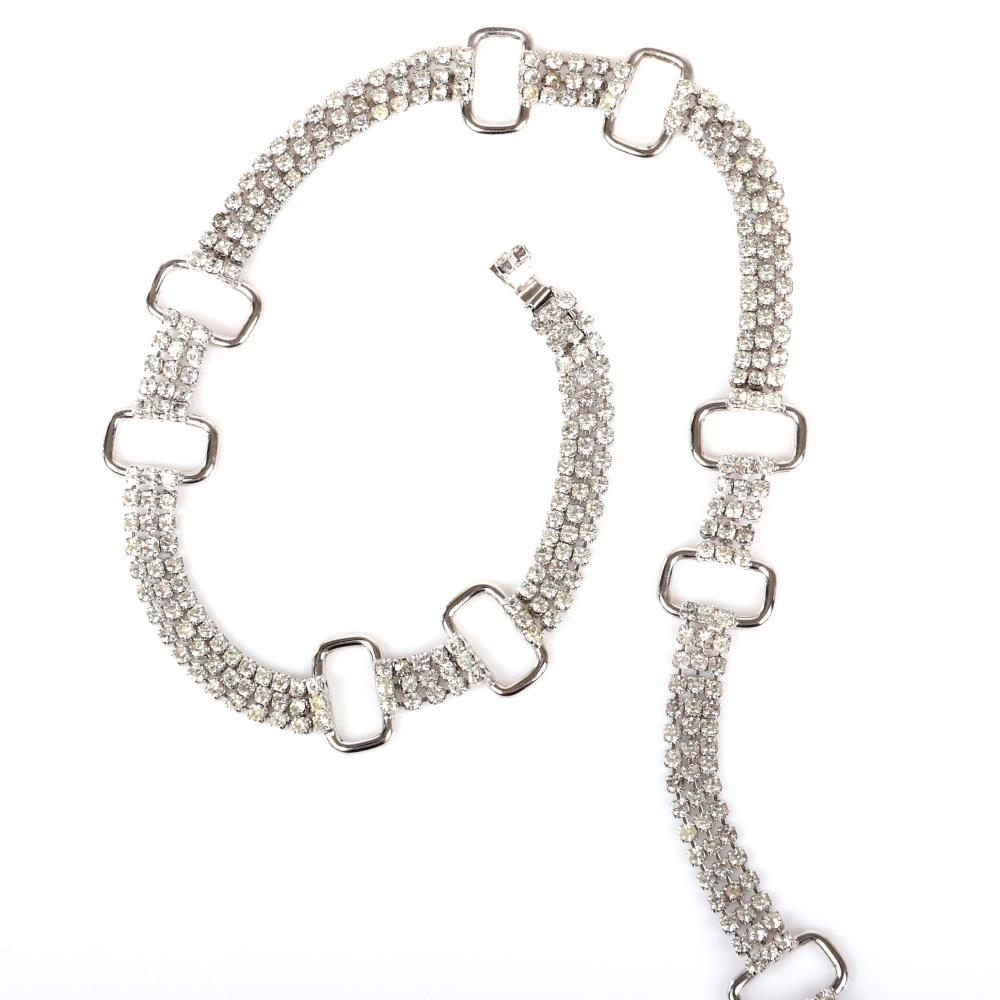 """Eisenberg rhodium plated belt with three-strands of rhinestones accented by large open metal links, marked Block E, c. 1950s. 36"""" x 1/2"""" with 3/4"""" ring accents"""