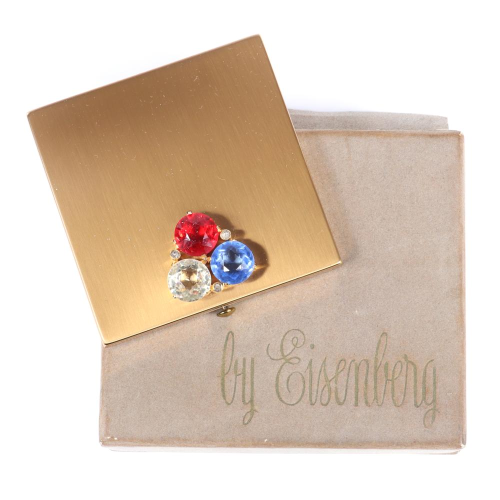 """Eisenberg Original square compact with three patriotic red, white and blue large prong-set rhinestones, bezel-set accents and gold pot metal in original box, c. 1943. 3"""" x 3"""""""