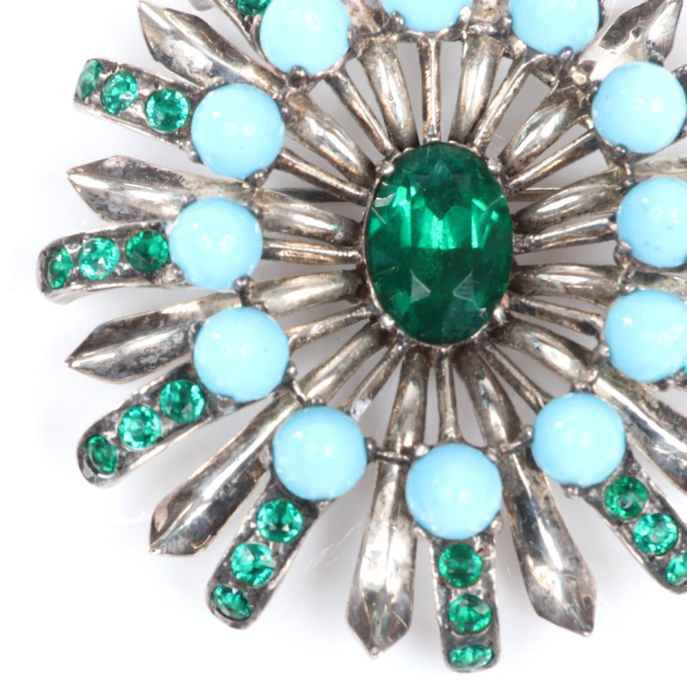 """Eisenberg Original layered silver floral brooch with large central emerald crystal, faux turquoise domed cabochons and green rhinestones. 3 1/2"""" diam."""