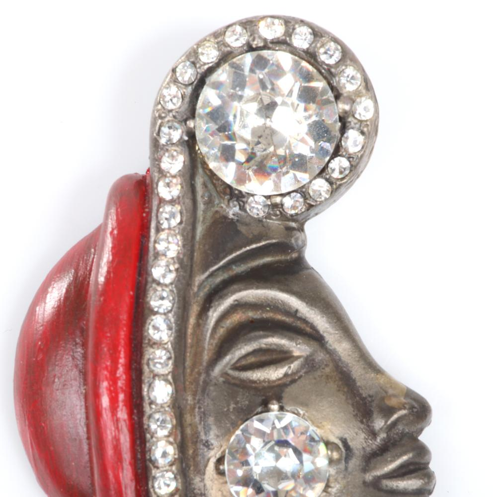 """Eisenberg Original Josephine Baker brooch in antiqued gold with two large rhinestones, a line of pave and red enamel hat. 2 1/2"""" x 2"""""""