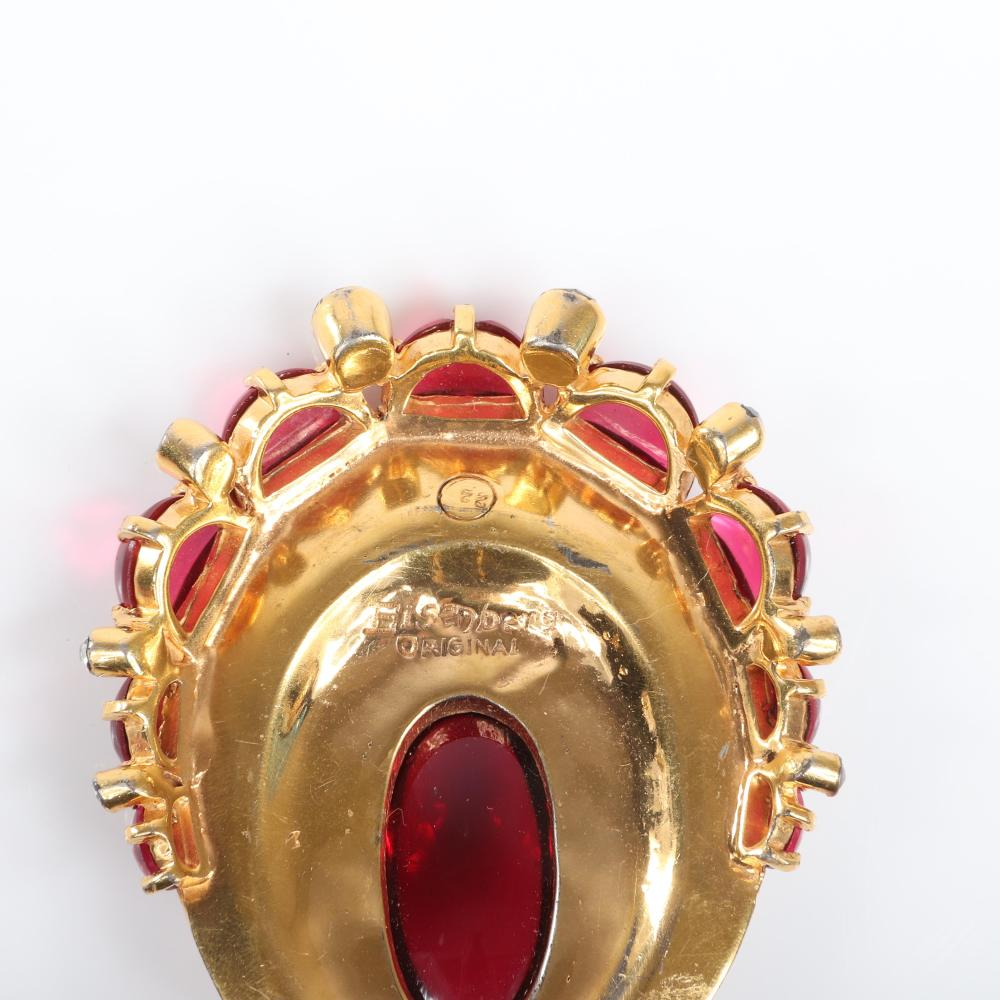 """Eisenberg Original gold washed oval fur clip with huge ruby glass cabochon surrounded by pave and ruby glass moon-shaped glass and large bezel-set crystals, stamped 22. 2 1/2"""" x 2"""""""