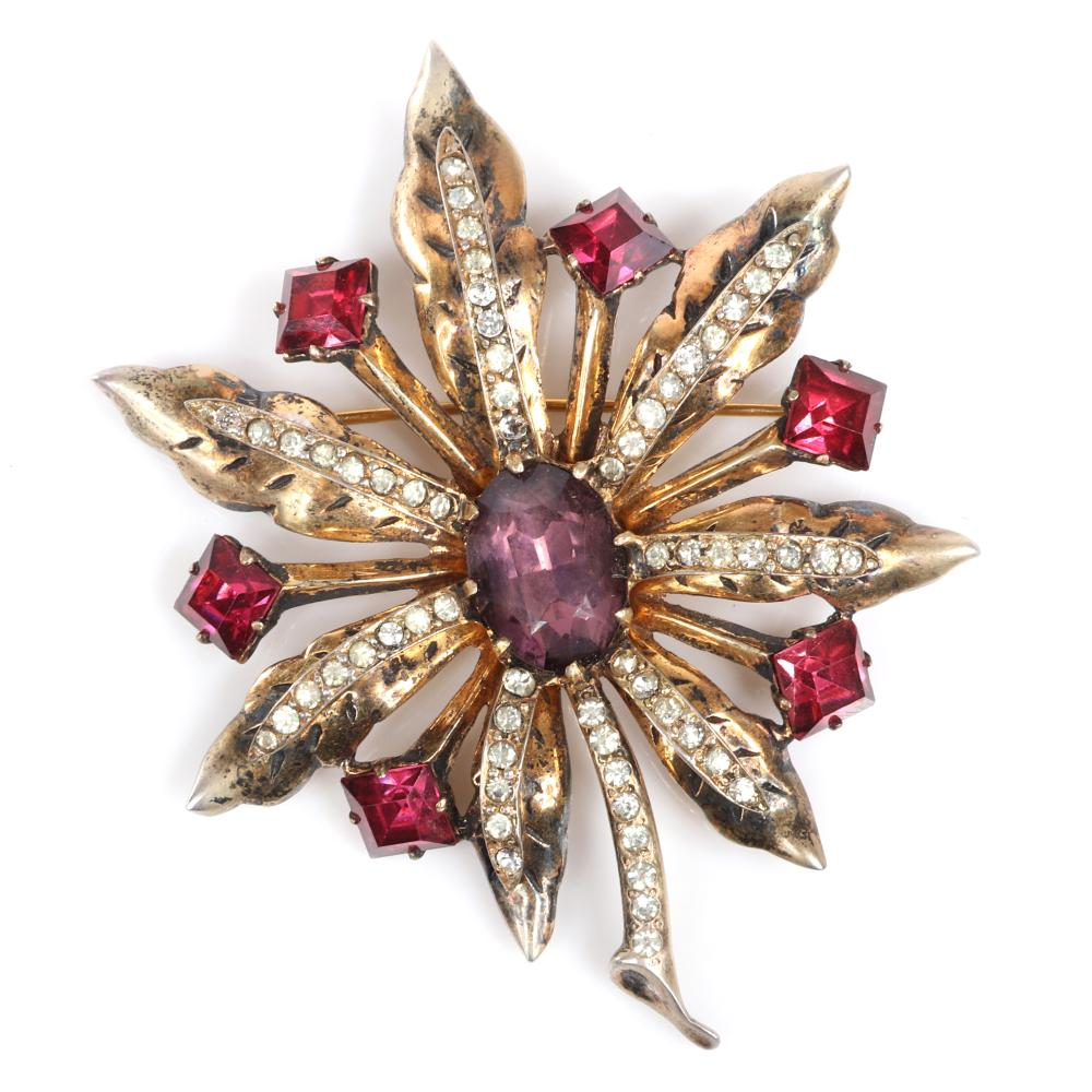 """Eisenberg Original sterling vermeil dimensional flower brooch with large lavender central crystal, six square ruby rhinestones and lines of pave, c. 1940s. 3 1/2"""" x 3"""""""