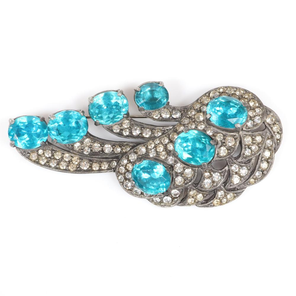 "Eisenberg Original layered abstract brooch in silver pot metal with seven large deep aqua faceted oval crystals and pave details, c. 1940s. 3 3/4"" x 1 3/4"""