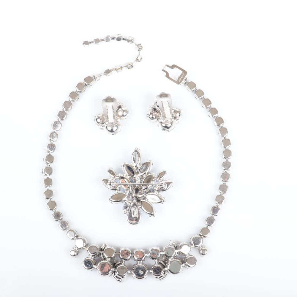 """Eisenberg sapphire crystal and pave group with matching necklace and earrings with semicircular rhinestone accents and layered brooch with marquise stones, c. 1950s. 16""""L"""" (necklace), 2""""H (pin)"""