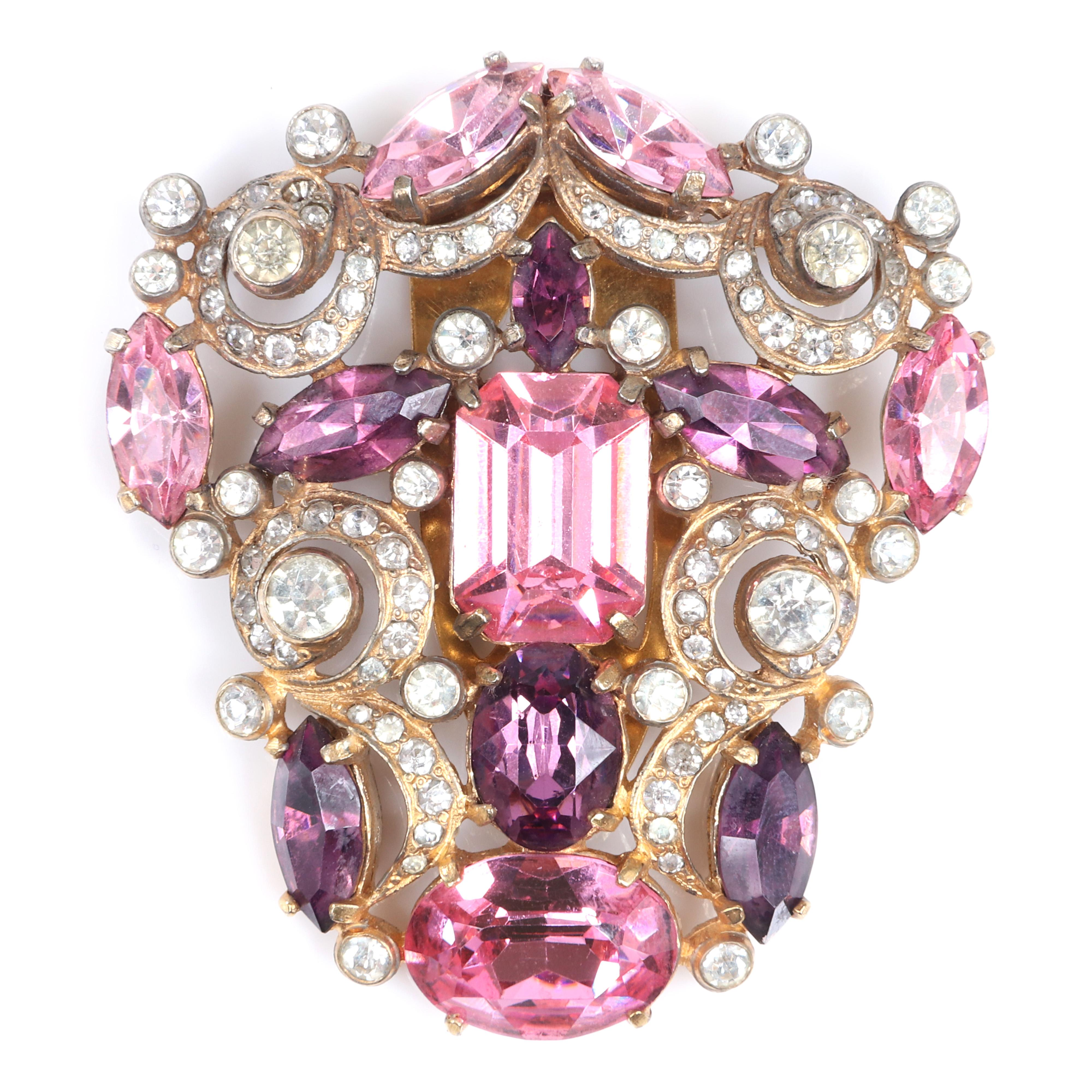 "Eisenberg Original Baroque dress clip with large pink and amethyst faceted crystal jewels, diamante and looping lines of rhinestones in gold washed pot metal, c. 1940s. 2 1/2"" x 2 1/4"""