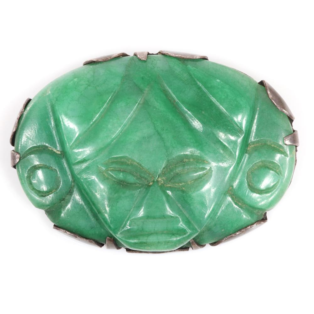 """Eisenberg Original Made in Mexico carved green onyx stone Mayan mask pin mounted in sterling silver with hand-incised mark, c. 1940s. 2"""" x 2 1/2"""""""