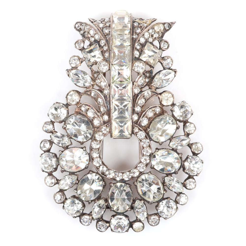 """Eisenberg original diamante circular fur clip with in silver pot metal with large rhinestones and lines of pave, c. 1940s. 3"""" x 2 1/4"""""""