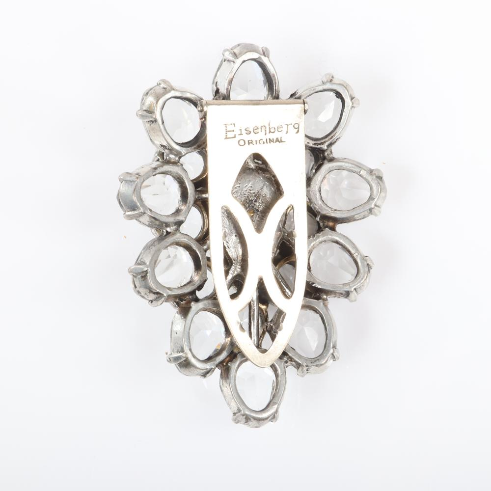 "Eisenberg Original teardrop crystal floral dress clip in silver pot metal with three layers of large faceted colorless crystal jewels, c. 1940s. 2 3/4"" x 2"" (clip), 1""H (teardrop crystal)"
