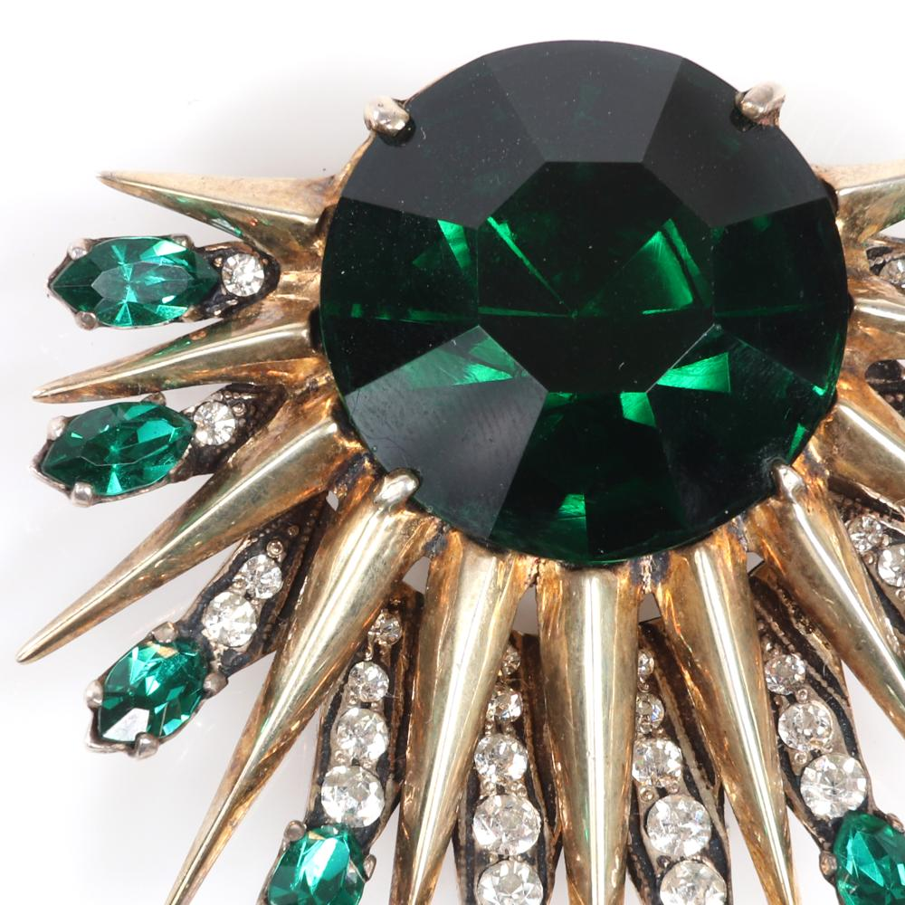 "Eisenberg Original shooting sterling vermeil shooting star fur clip with huge 1"" emerald faceted crystal stone surrounded by gold spikes rays tipped in green marquises, c. 1940s. 2"" x 2"""