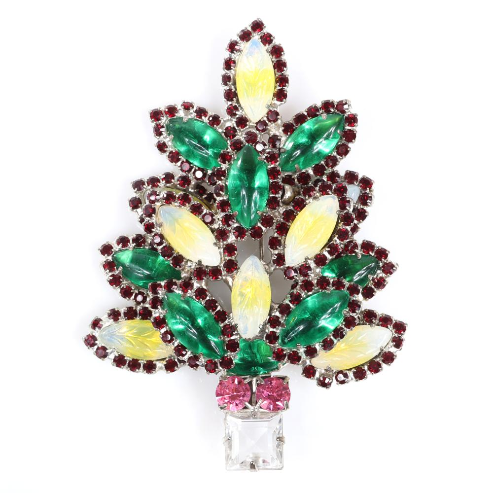 "Eisenberg Ice Holiday tree brooch with pink and colorless square stone trunk, layered green and citrine marquise crystals surrounded by lines of deep blue rhinestones. 3 1/2"" x 2 1/2"""