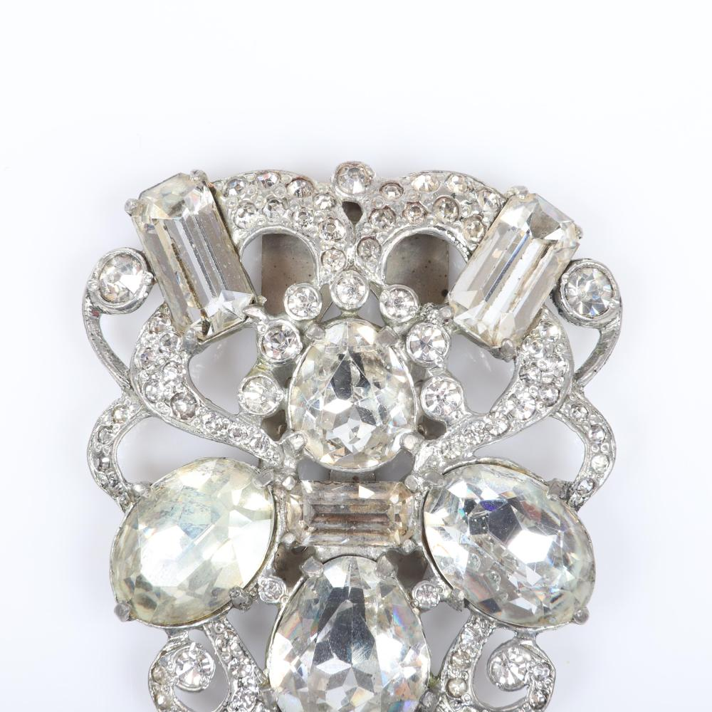 """Eisenberg Original baroque shield form dress clip with large colorless crystal diamante jewels and rhinestones in pot metal, c. 1940s. 2 3/8"""" x 2"""""""