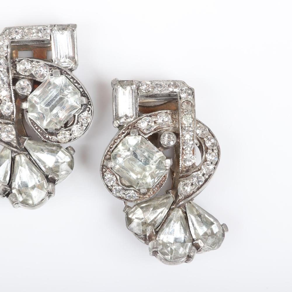"""Eisenberg Original pair of diamante dress clips in silver pot metal with emerald and teardrop crystals and lines of rhinestones, c. 1940. 1 3/4"""" x 1 1/2"""""""
