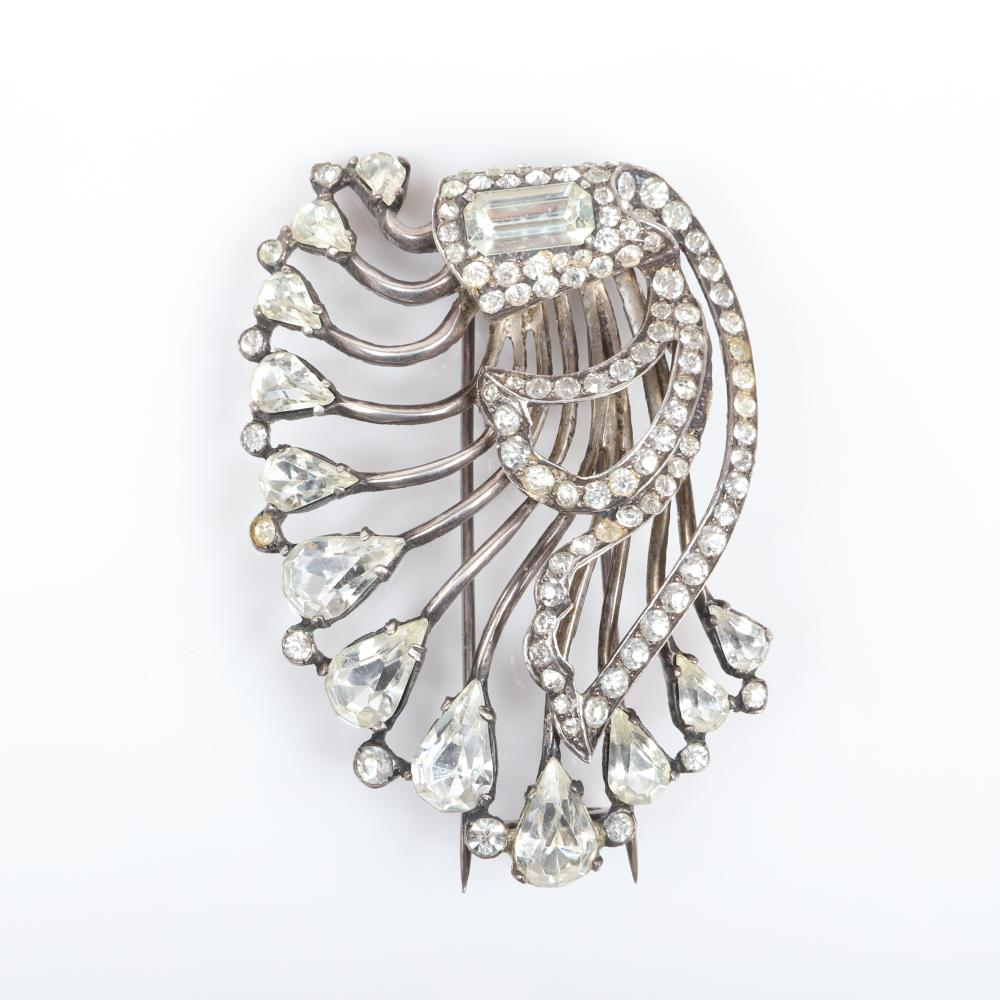 """Eisenberg Original sterling silver openwork, harp-shaped fur clip with a large emerald-cut jewel, lines of rhinestones, tipped in teardrop crystals. 3"""" x 2"""""""