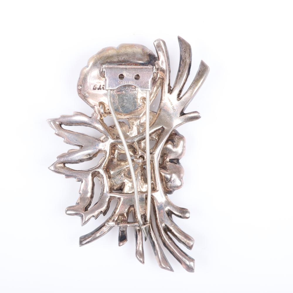 """Eisenberg Original sterling diamante floral spray pin in silver metal with large central flower with pear shaped crystals & rhinestone encrusted stems & leaves, setter's mark. 3"""" x 2 1/4"""""""