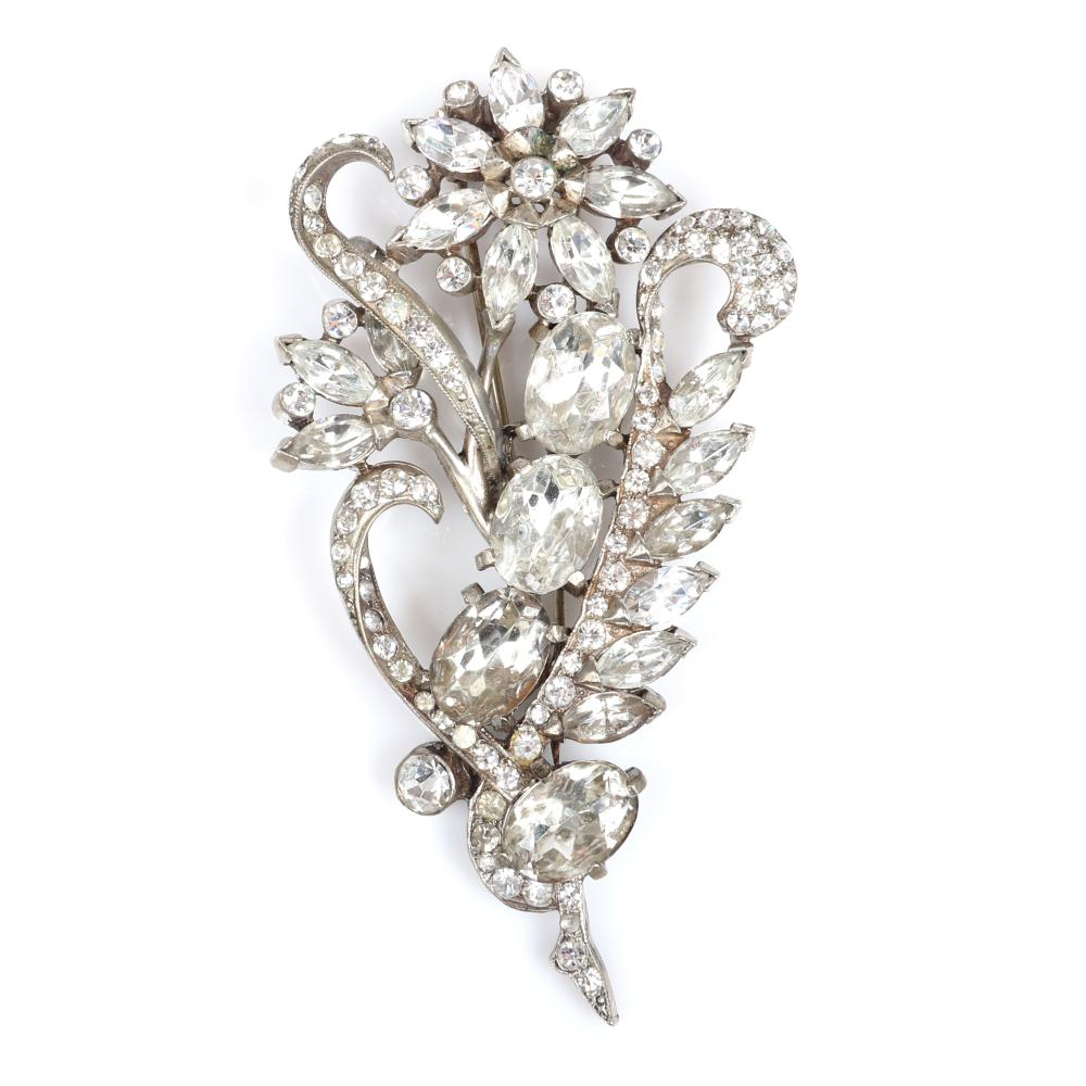 """Eisenberg Original diamante jeweled floral spray with silver pot metal, large crystals in various sizes and shapes and lines of rhinestones, c. 1941. 3 3/4"""" x 2 1/4"""""""