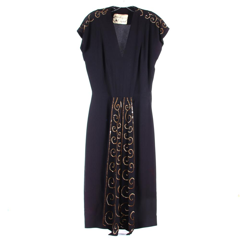"""Eisenberg & Sons Original black rayon crepe dress with deep V-neck, bodice tailoring, fitted skirt and two long panels with elaborate beaded panels with gold sequins, c. 1940s. 48""""L"""