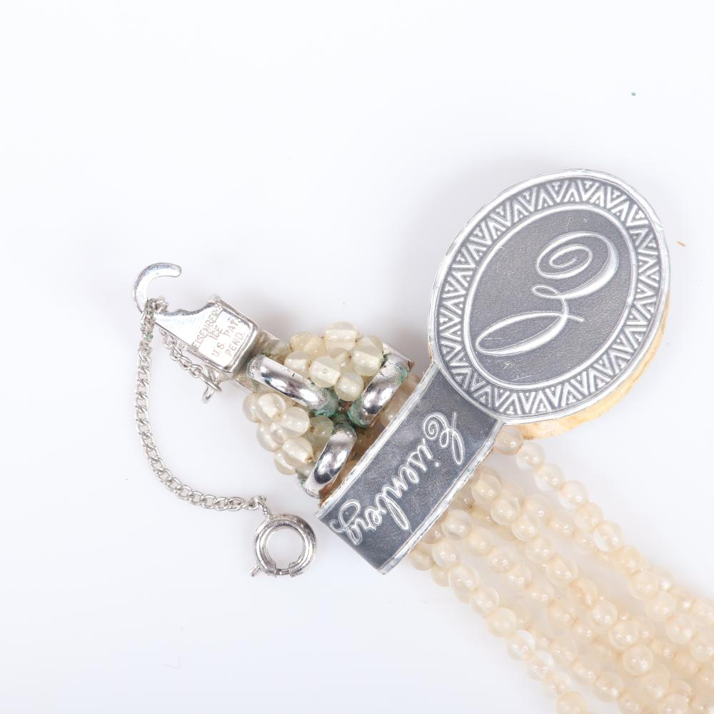 "Eisenberg seven-strand faux pearl bead bracelet with pave rhinestone T-clasp and original foiled label with script E and coordinating rectangular pave stick pin. 8""L (bracelet)"