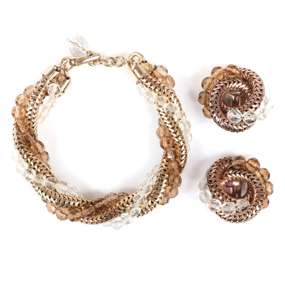 """Eisenberg bracelet earring set with twisted strands of gold tone snake chain and strands of smoke and colorless faceted crystal beads, c. 1950s. 8""""L (bracelet), 1 1/4""""diam (earrings)"""