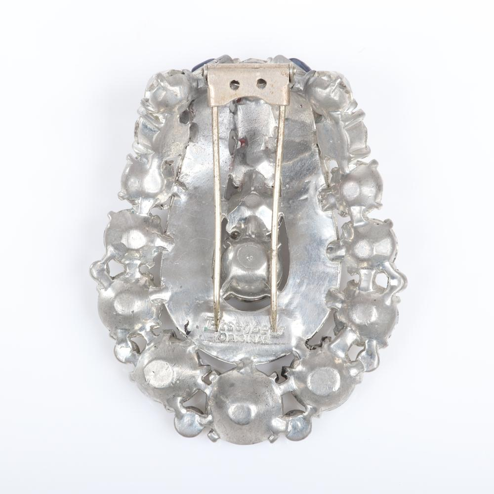 "Eisenberg Original dimensional U-shaped Deco fur clip with graduated crystals that taper along the outside and inside rows row and channel-set blue baguettes, 1942. 2 3/4"" x 2 1/4"""