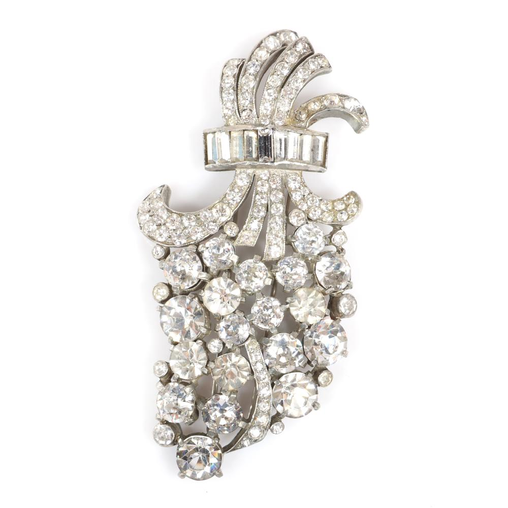 "Eisenberg Original patented large floral spray fur clip in silver pot metal with large prong-set stones accented with pave and baguettes, with setter's mark number 22, c. 1942. 4"" x 2 1/8"""