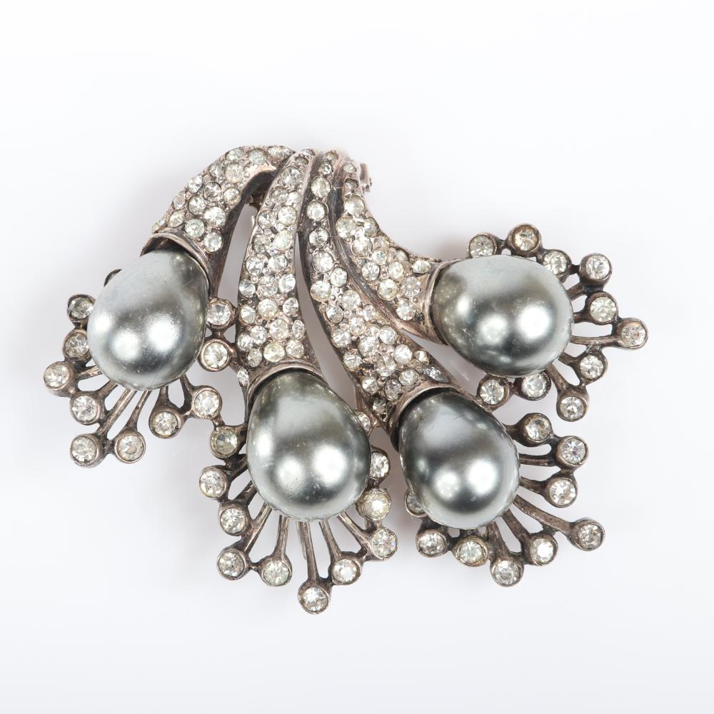 """Eisenberg Original sterling demi-parure fur clip with four pave encrusted cornucopias tipped in massive gray pearls and bezel-set stones with matching earrings, c. 1943. 2 1/4"""" x 2 3/4"""" (clip), 1"""" x 3/4"""" (earrings)"""