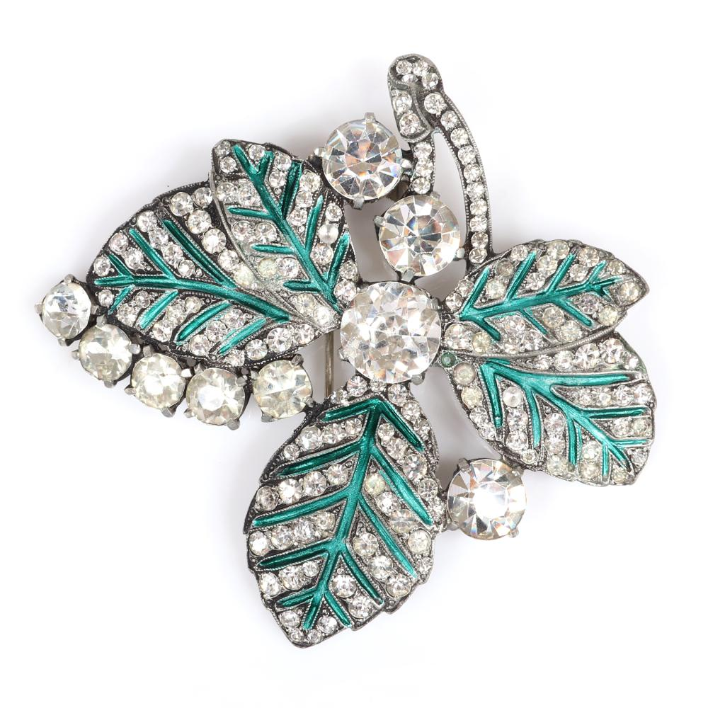 "Eisenberg Original large leaf fur clip with setters mark, pot metal and leaves decorated in green enamel surrounded by pave and larger prong-set rhinestones. 3 1/4"" x 3 1/2"""