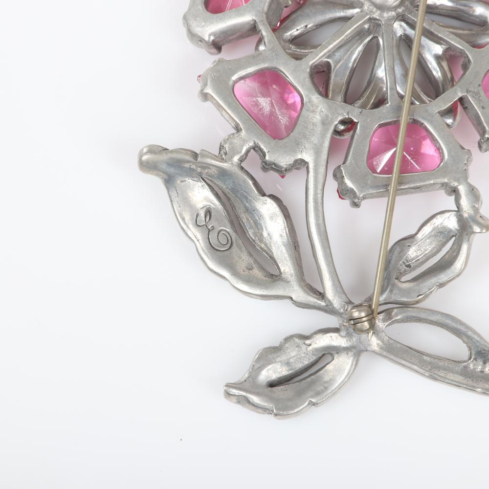 "Eisenberg pink and clear floral brooch with pot metal and seven large wedge-shaped faceted crystal pink petals and pave and central bezel-set stone, early 1940s. 3 1/2"" x 2 3/4"""