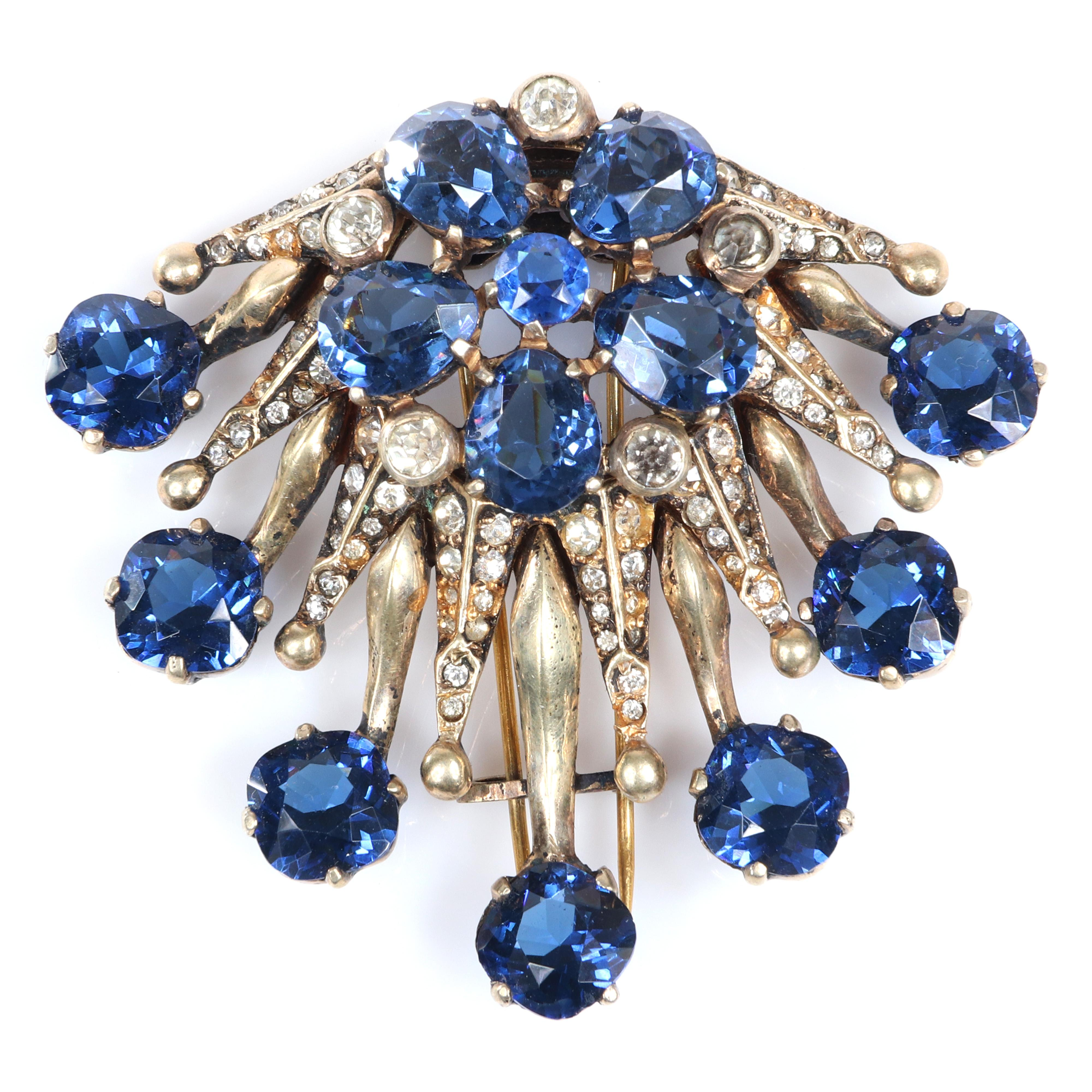 """Eisenberg Original sterling vermeil dimensional Deco fur clip central flower and tips of blue faceted crystals and spikes with pave rhinestones and bezel-sets, mid-1940s. 2 1/2"""" x 2 3/4"""""""