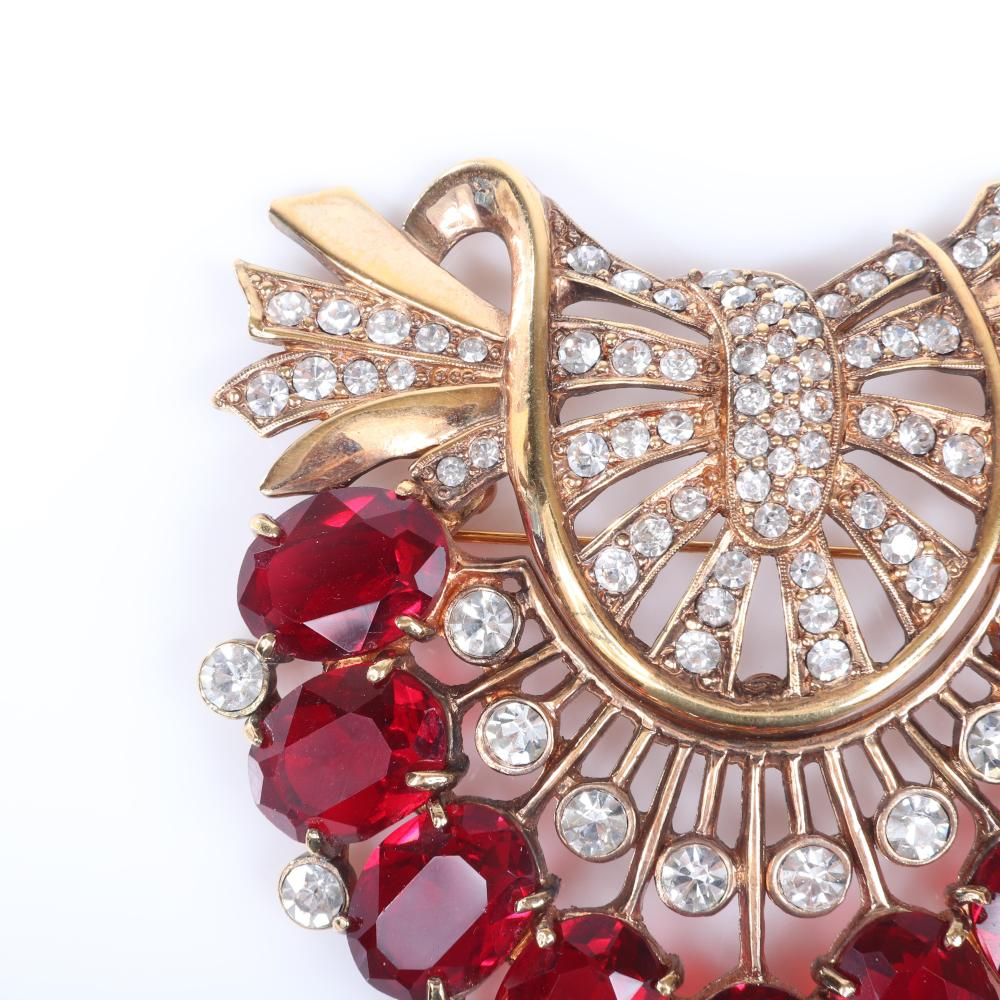 """Eisenberg Original brooch in antiqued gold pot metal with 9 ruby crystals & a half circle of pave and bezel-sets, c. 1940, Includes Vogue 1937 original advertisement of this pin. 3 3/8"""" x 3 1/2"""""""