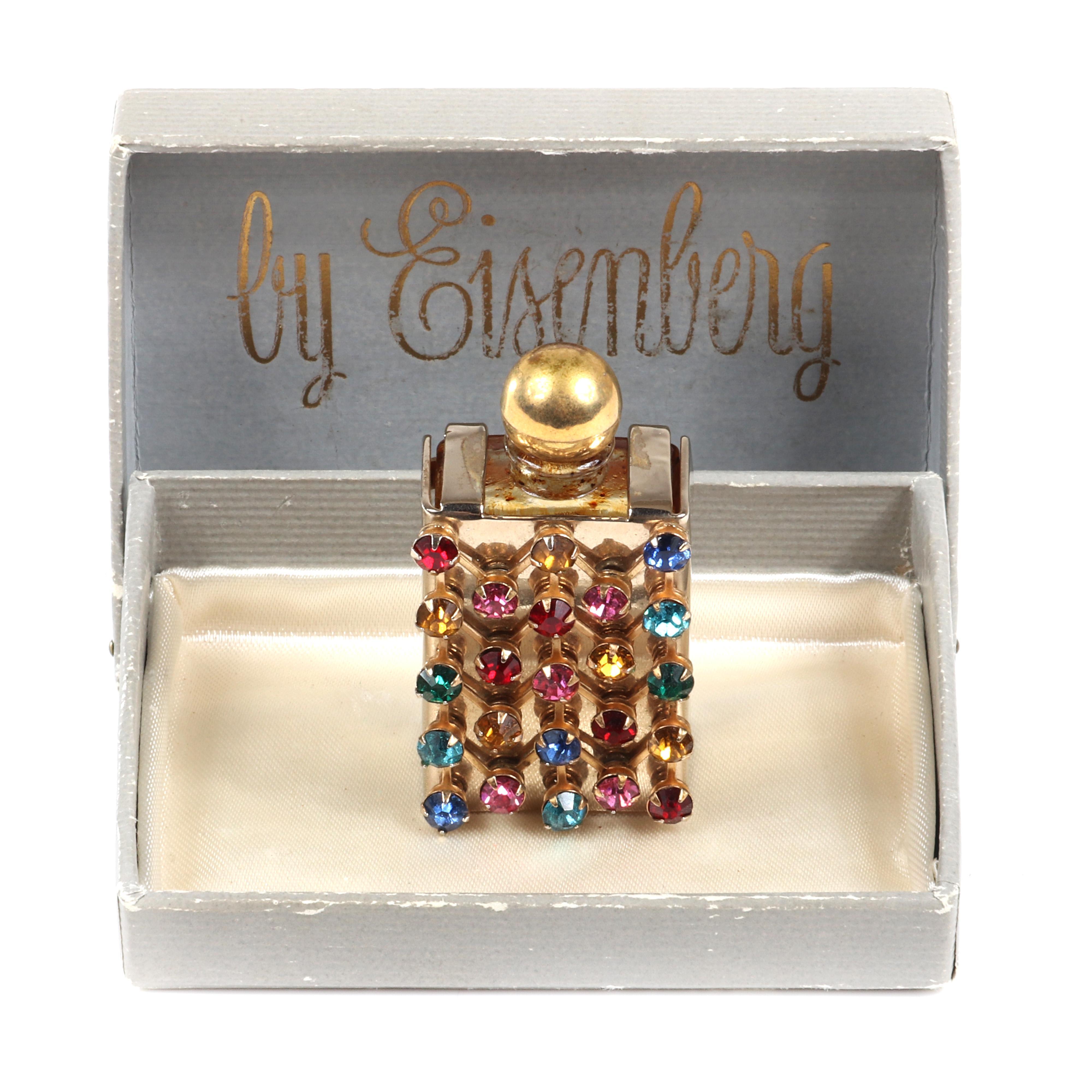 "Eisenberg Originals jeweled perfume bottle in original box with twenty-three jewel-tone, multi-colored, prong-set round rhinestones on gold tone framework, c. 1940s 2 3/4"" x 1"" (bottle)"