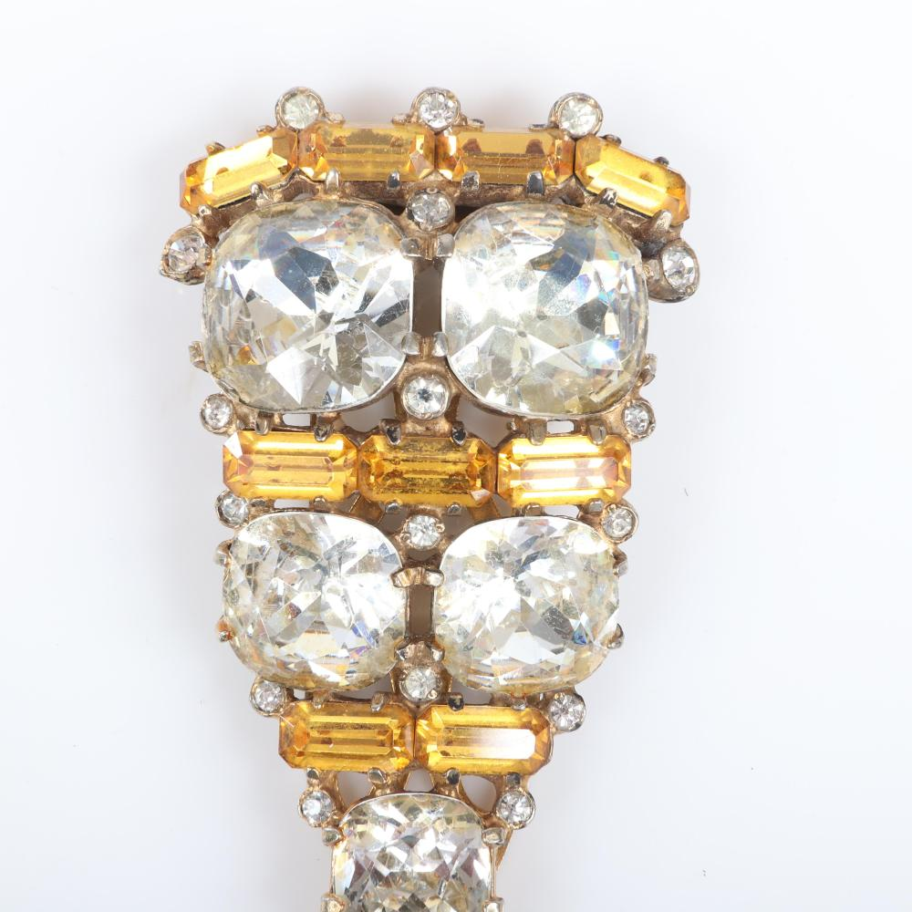"Eisenberg Original triangular amber accented fur clip in gold washed pot metal with large clear round crystals and four rows of amber emerald-cut stones, c. 1940. 2 3/4"" x 1 3/4"""