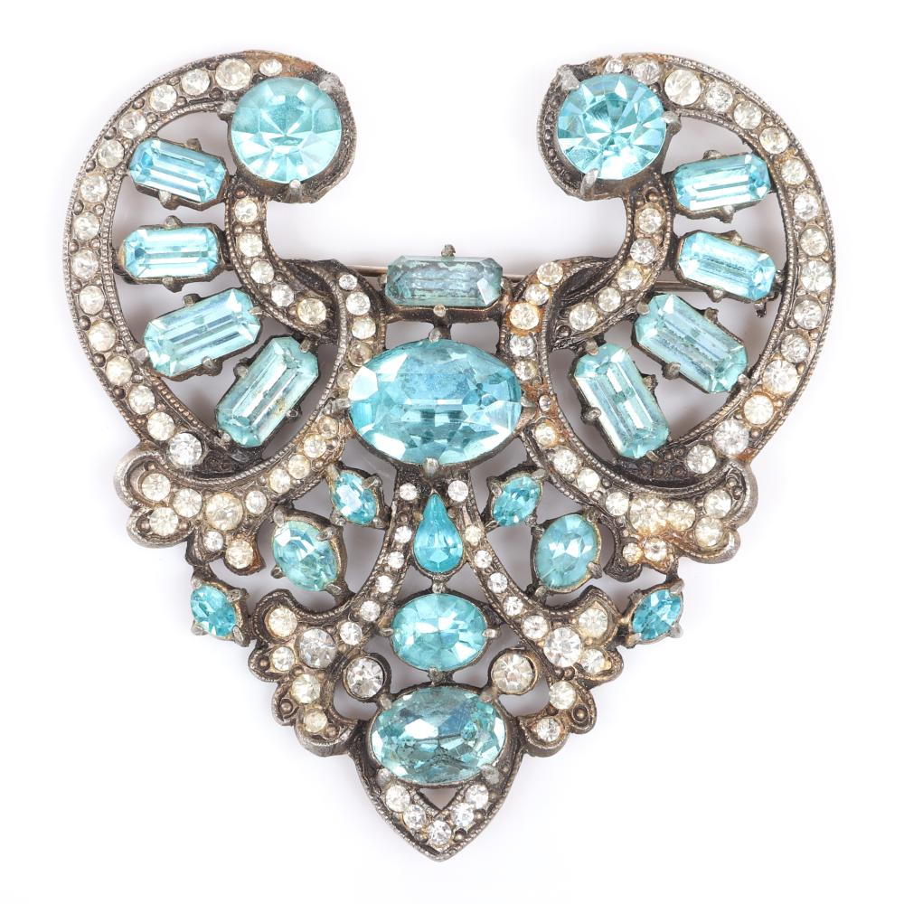 "Eisenberg Original aqua rhinestone open work brooch in antique gold pot metal with swirling lines of pave and aqua crystals in various sizes and shapes, c. 1940. 3 1/2"" x 3 1/4"""