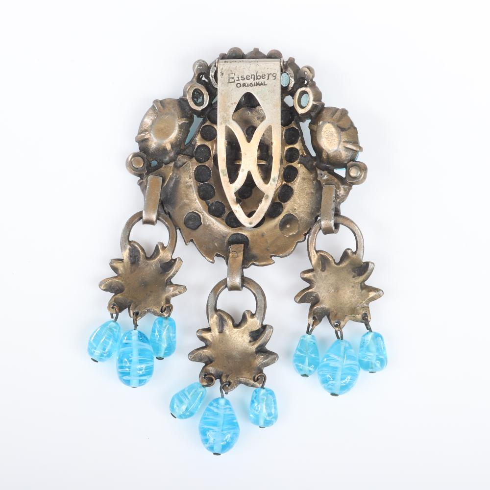 "Eisenberg Original huge articulated dress clip with antiqued gold pot metal, aqua crystals, bezel-set rhinestones and three flower drops with dangling aqua glass beads, c. 1930s. 4 1/2"" x 3"""