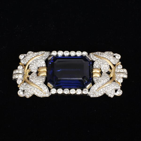Trifari Alfred Philippe Pin Brooch; gold wash featuring blue emerald cut sapphire crystal and pave rhinestones.