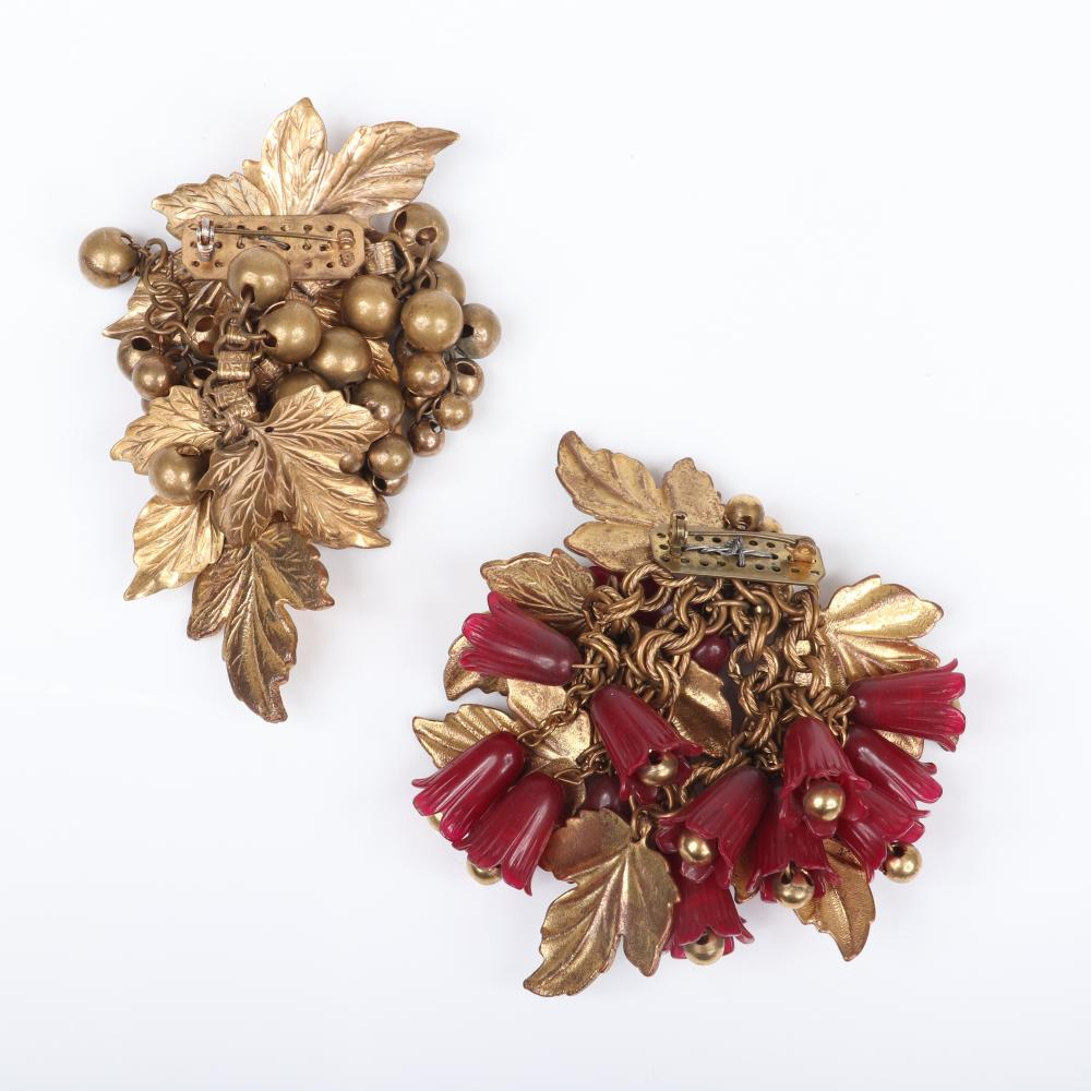 Unsigned early Miriam Haskell two brass pins with dangling leaves and bell beads, one with red celluloid bell flowers.
