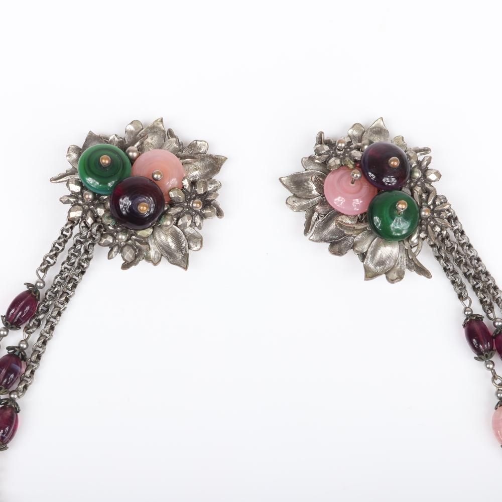Unsigned Miriam Haskell silver tone chatelaine with pink, green and purple poured glass beads and disks in central flowers.
