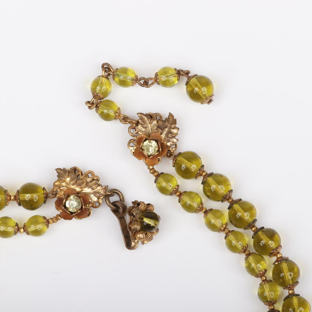 Miriam Haskell 3pc double strand citrine glass bead necklace with large crystal pendant, floral pin and earrings with green and colorless rhinestones.