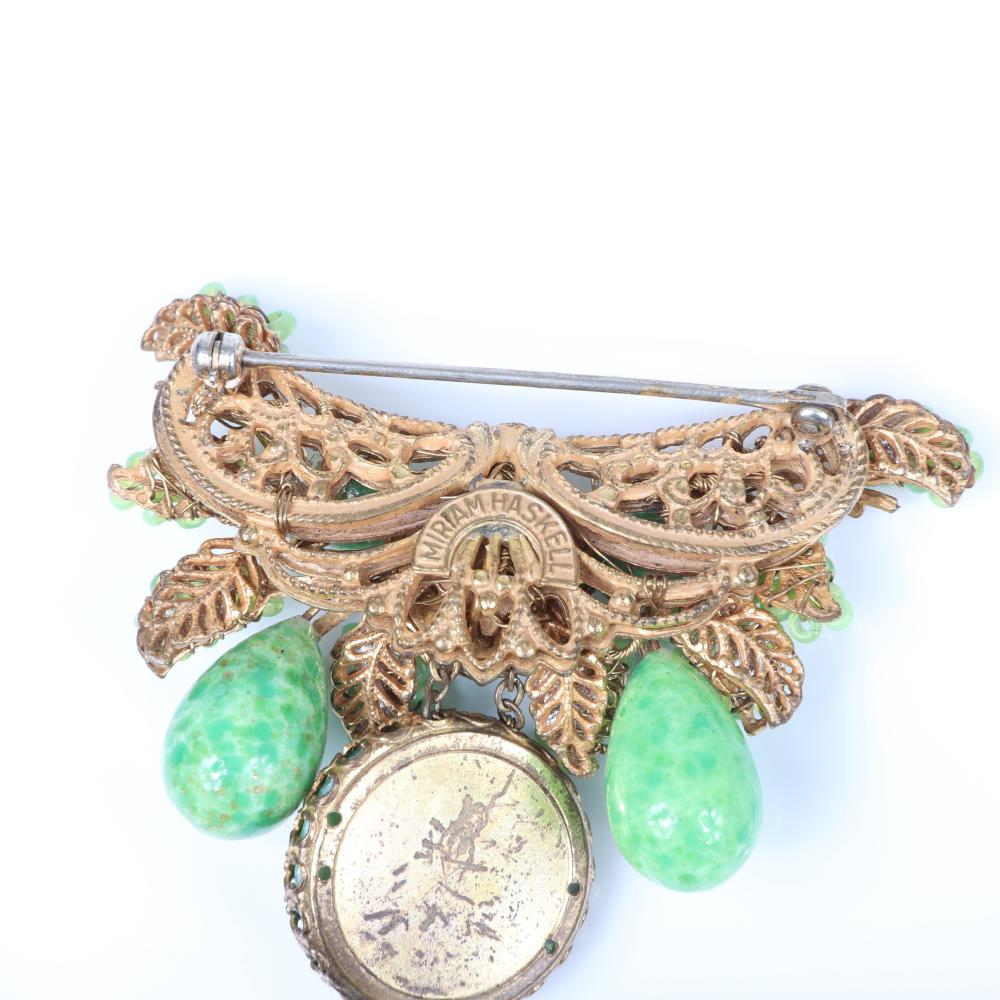 Miriam Haskell necklace, earring and pin group with green poured glass, faux pearls, green glass beads and rhinestones.