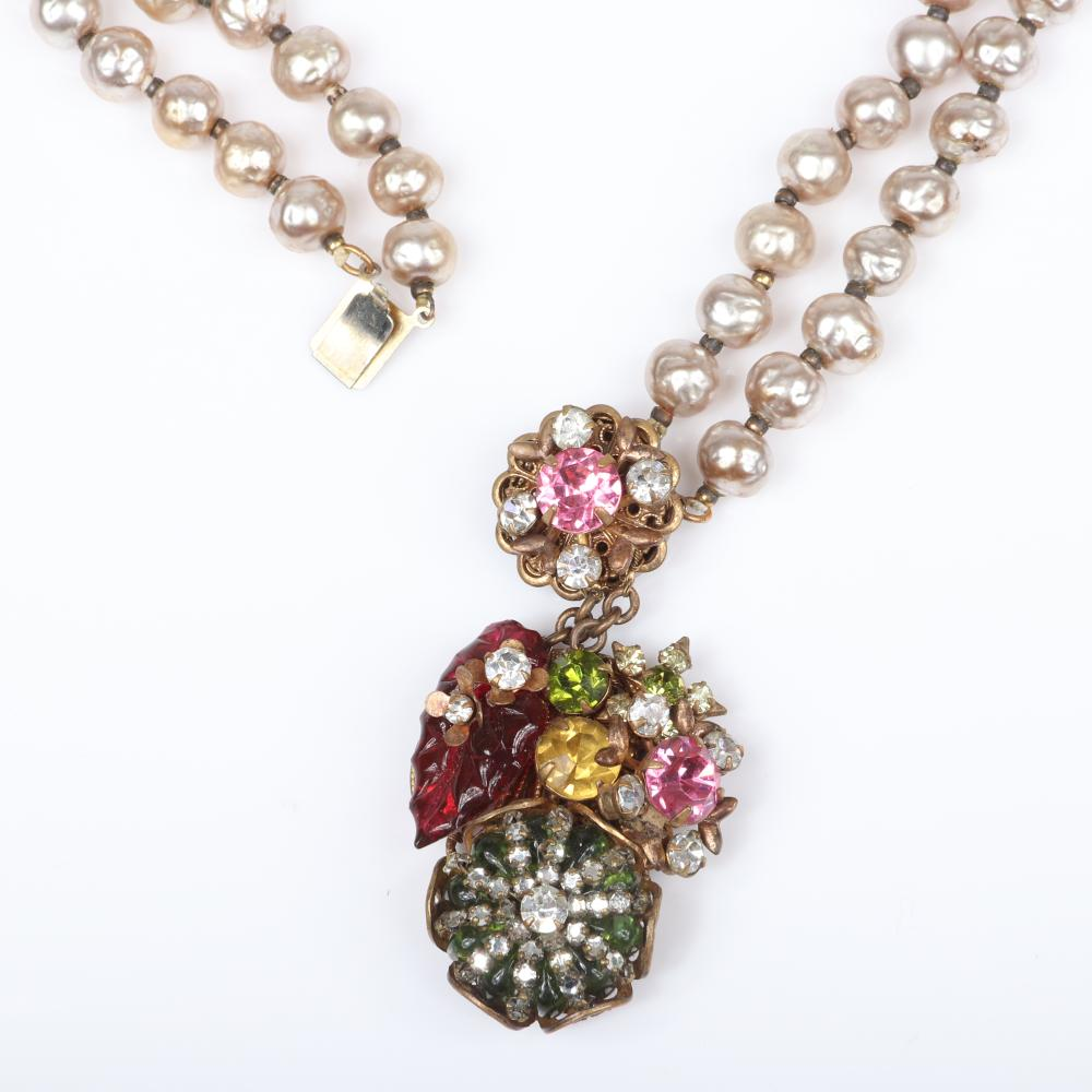 Miriam Haskell double strand Baroque silver pearl necklace with jewel tone poured glass beads, rhinestones, pink crystals, with coordinating earrings.