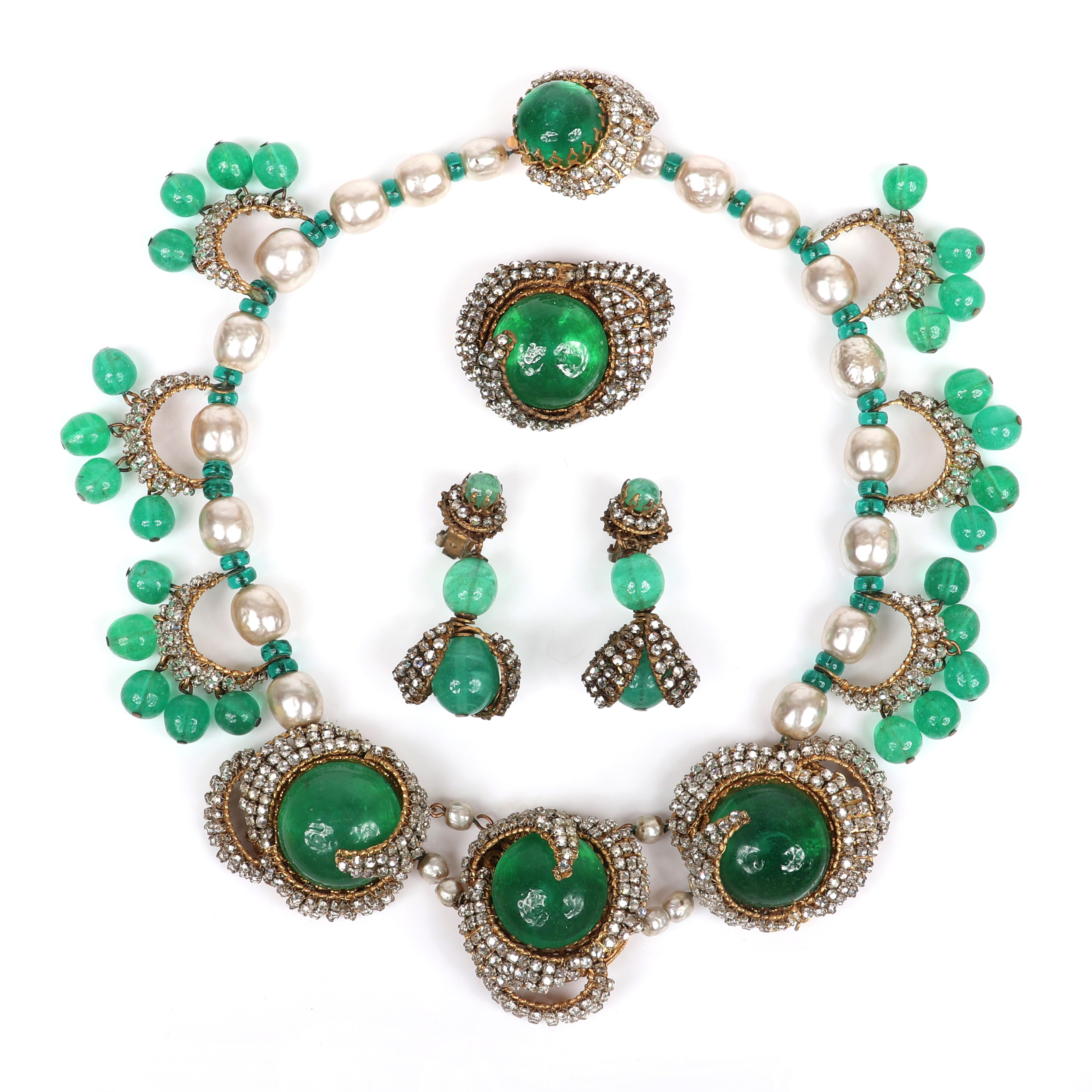 Miriam Haskell emerald green 3pc. parure; collar necklace with pave rhinestone encrusted glass cabochons and crescent stations with dangle beads, with matching pin brooch and earrings.
