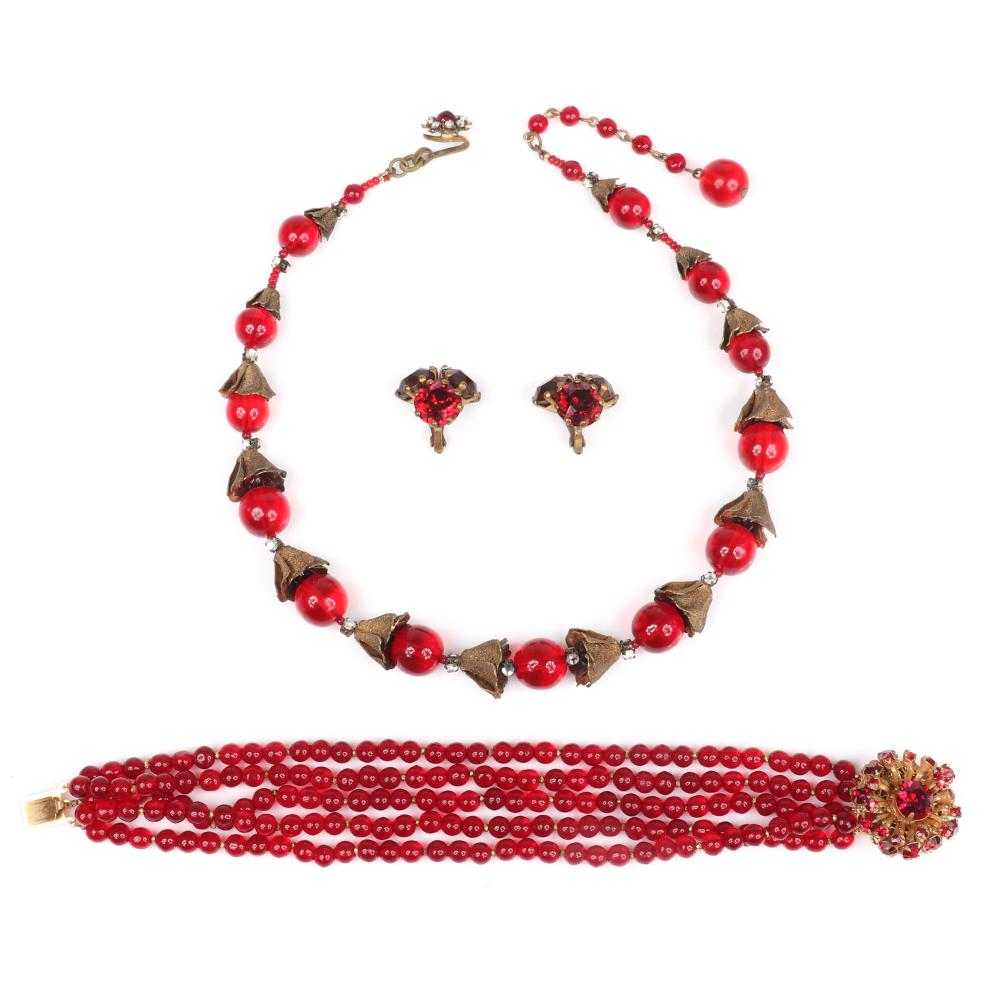 Miriam Haskell 3pc ruby glass bead and molded brass flower cup necklace with 4-strand glass bead bracelet with red rhinestone clasp, with large rhinestone earrings.