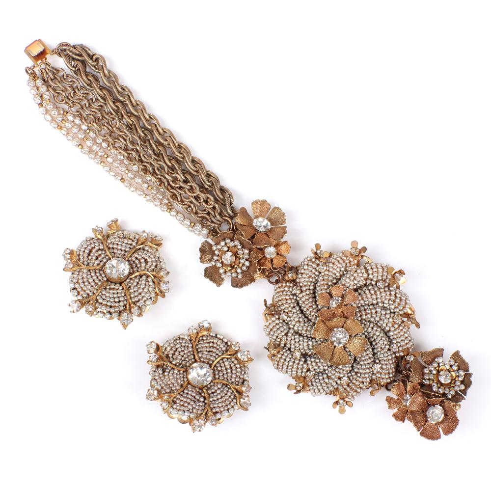 Miriam Haskell 8-strand chain and faux pearl bracelet with floral detail, rhinestones and seed pearl pinwheel and coordinating earrings.