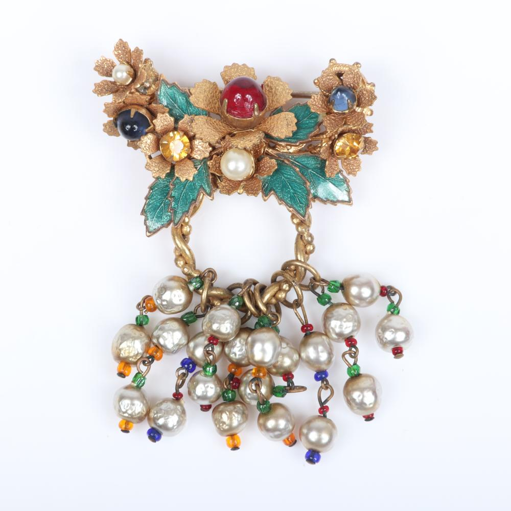 Miriam Haskell green enameled leaf 2pc set; layered floral cluster brooch with red cabochon, rhinestones and 10 beaded of dangling fringe faux pearls, with dangling bell earrings.