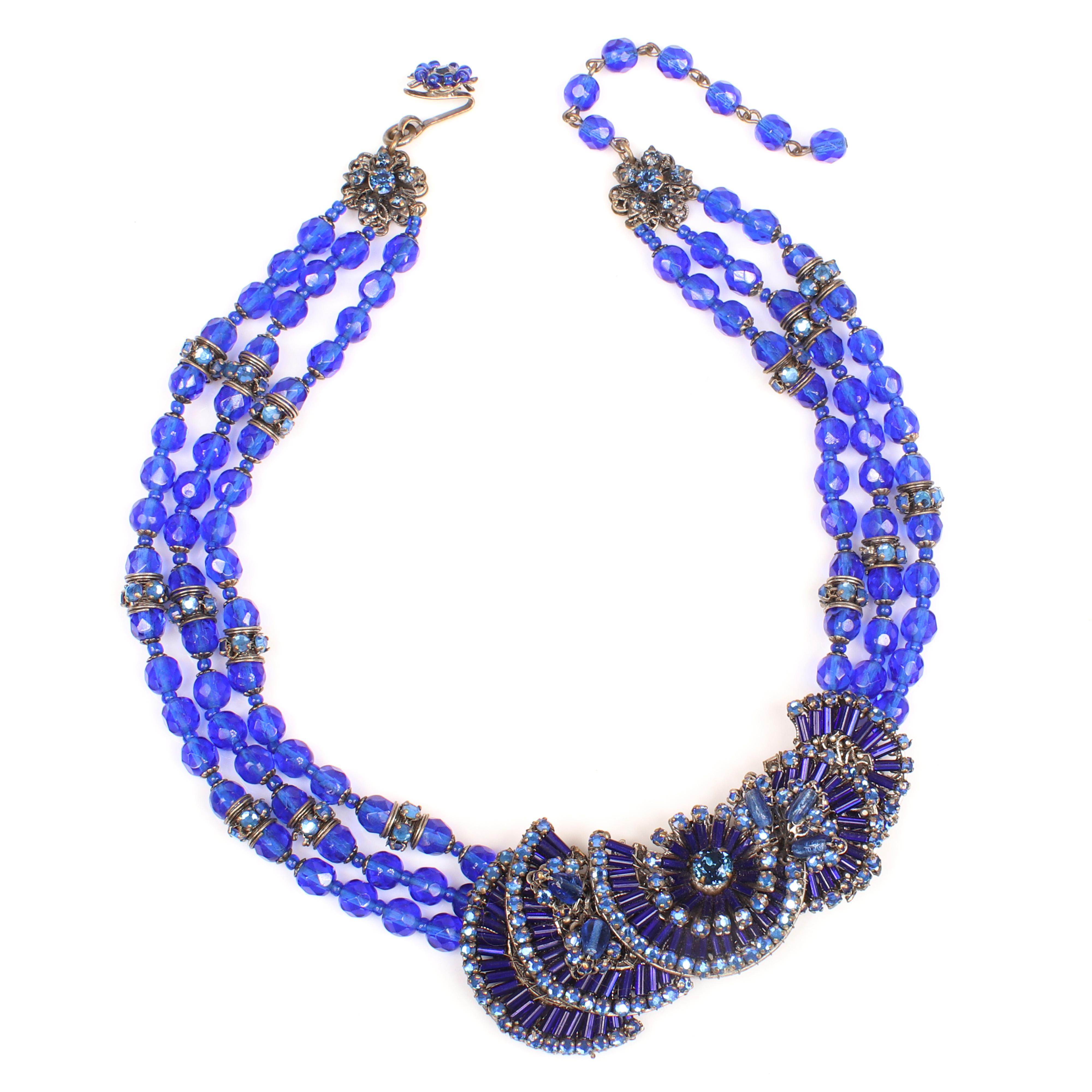 Miriam Haskell triple strand necklace with blue glass beads, rondelles and layered fan flourish.