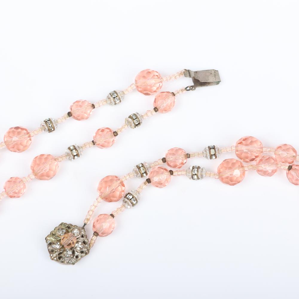 Miriam Haskell pink 3pc group; double strand heavily faceted pink crystal bead necklace with rhinestone rondelles, dangling prism earrings and diamante cluster pin.