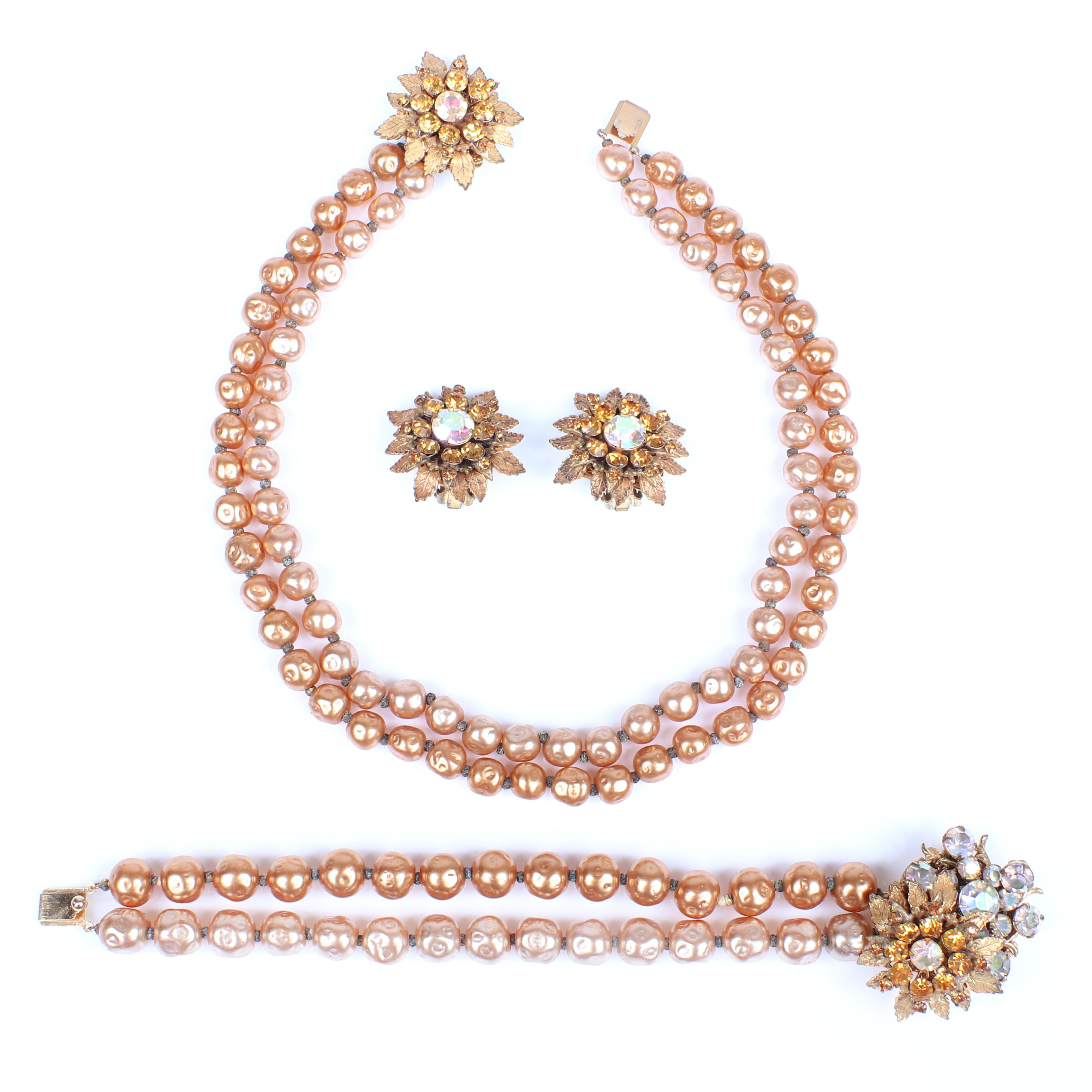 Miriam Haskell 3pc. parure with double strand golden baroque pearl necklace and bracelet, with amber rhinestone and aurora borealis crystal floral cluster earrings and clasps.