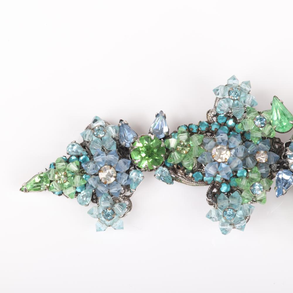 Large Eugene vintage green and aqua blue crystal and rhinestone jewel encrusted flower cluster spray pin brooch.